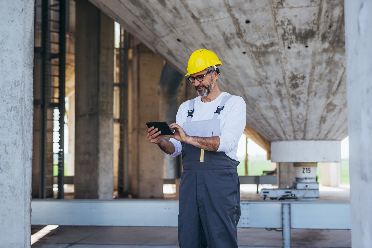 construction worker using tablet on site